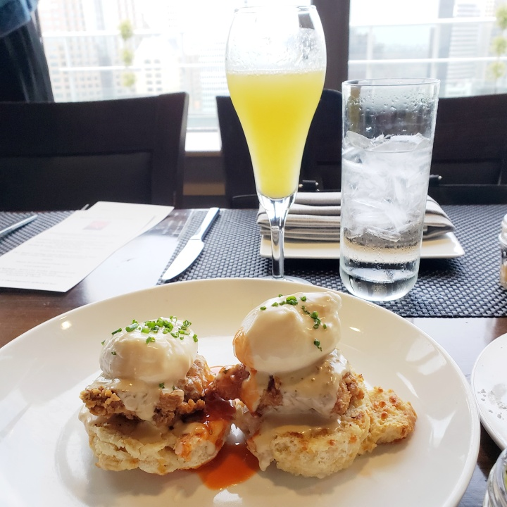 Fried Chicken Benedict (Cheddar biscuit, Shoyu Creme, Pineapple Papaya Marmalade) at Fahrenheit Charlotte brunch in North Carolina