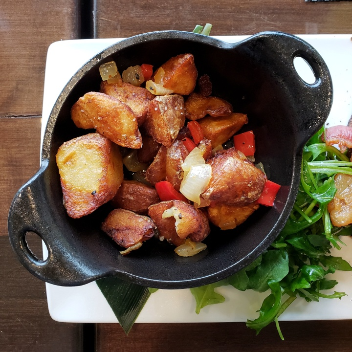 Potatoes (side item with the B.A.E.; potato, onion, and red pepper in cast iron skillet) at Fahrenheit Charlotte brunch in North Carolina