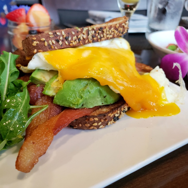 The B.A.E. (Heritage Farms bacon, avocado, eggs, Ashe County cheddar, Arnold multi-grain bread) at Fahrenheit Charlotte brunch, in North Carolina