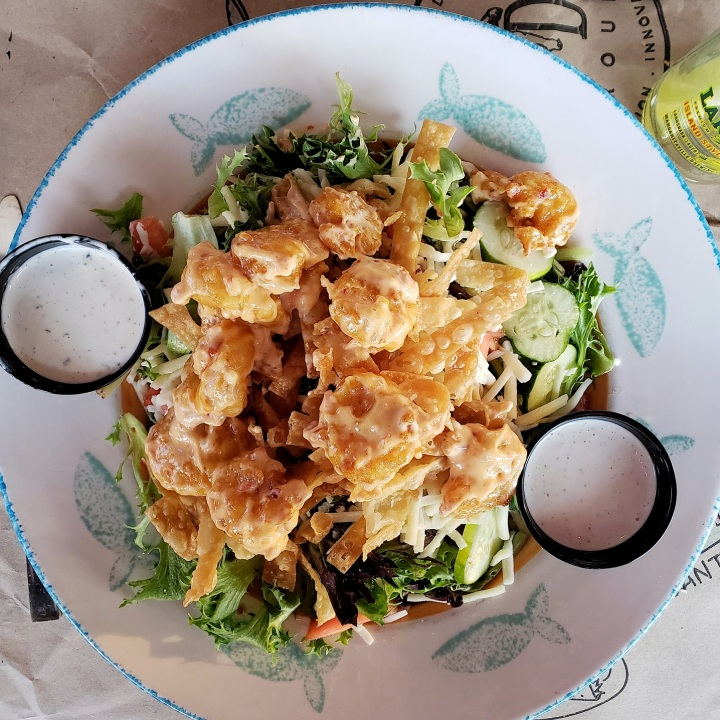 Bangin' Shrimp Salad at Pawley's Raw Bar in Pawley's Island SC (fried shrimp tossed in housemade bangin' sauce, over fresh greens, tomato, cucumber, Monterey Jack, and fried wonton strips)