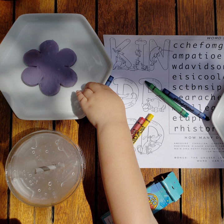 Kids menu with crayons and play dough, at Kindred restaurant in Davidson, NC