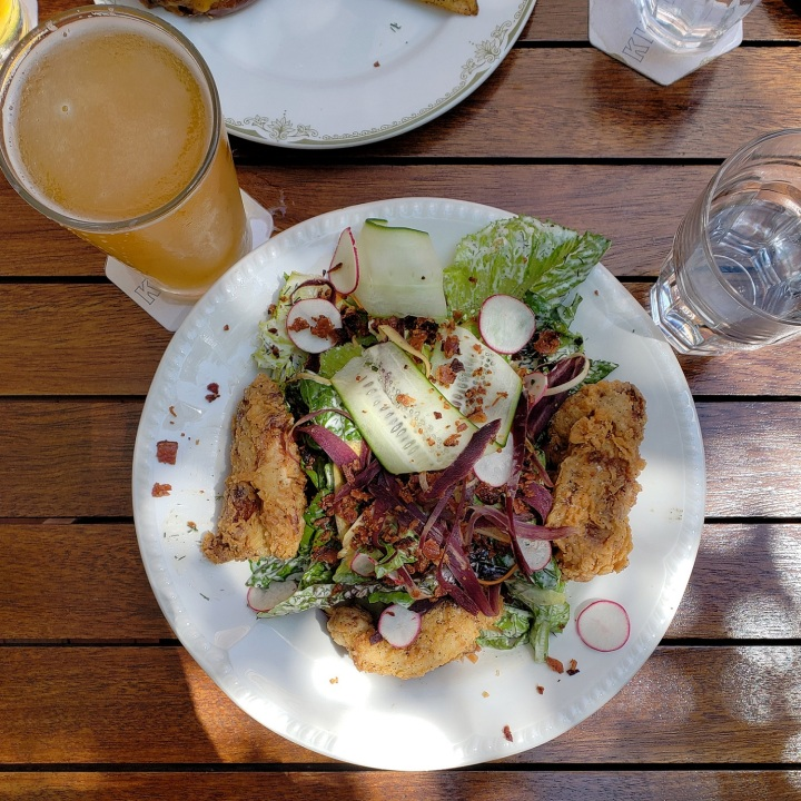 Buttermilk Fried Chicken Salad (heirloom carrot, bacon, cucumber, radish) at Kindred restaurant in Davidson, NC